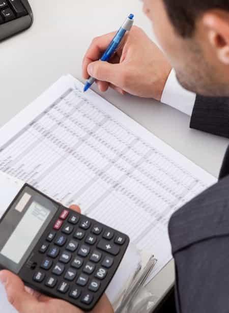 main-man-caculcating-spreadsheets